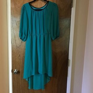 Dresses & Skirts - Green Dress with black trim and peak a boo sleeves